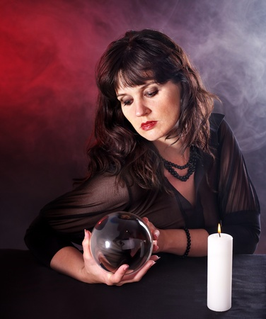 clairvoyance: Young woman  with crystal ball. Beauty and fashion.