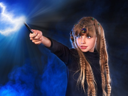 wizard hat: Girl in witchs hat with magic wand casting spells. Stock Photo