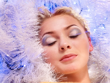 Young beautiful woman with Christmas make up. photo