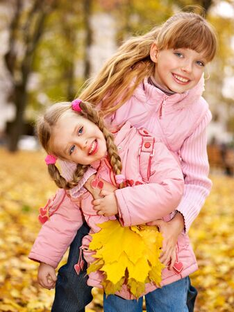 Children in autumn orange leaves. Outdoor. Stock Photo - 10971456