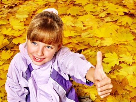 Child in autumn orange leaves. Outdoor. Stock Photo - 10971604