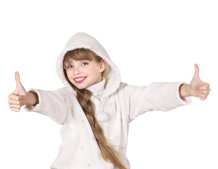 Young girl in white winter jacket showing thumb up. Isolated. photo