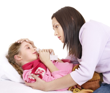 Sick little girl with mother. Isolated. Stock Photo - 10971515