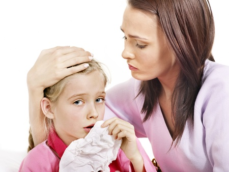 cough medicine: Sick little girl with mother. Isolated. Stock Photo