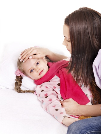 Sick little girl with mother. Isolated. Stock Photo - 10971547