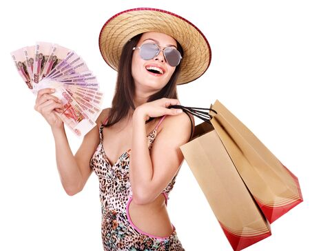 Woman with  money and shopping bag. Isolated. photo