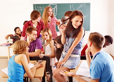 Group student in classroom near blackboard. Stock Photo - 10971562