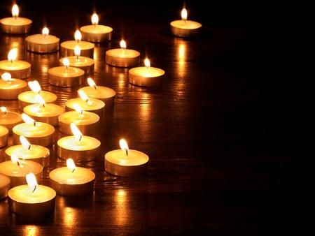 Group of burning candles on  black background. photo