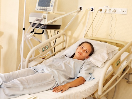 hospital trolley: Sick patient on gurney in operating room.