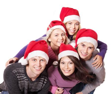 Skupina mladých lidí v santa klobouku. Isolated. Reklamní fotografie - 11174857