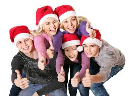 super woman: Group young people in santa hat showing thumb up. Isolated. Stock Photo