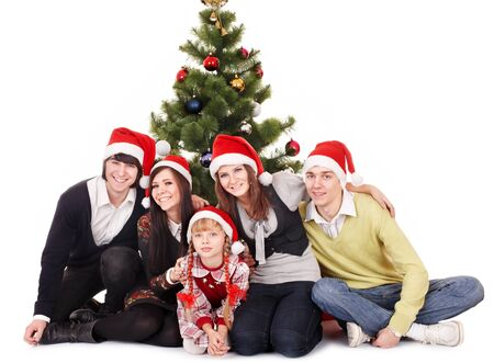 Happy group people with children in santa hat .  Isolated. photo