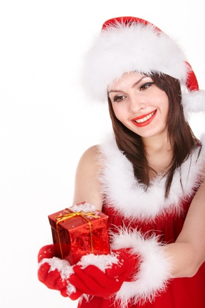 Girl in santa hat giving red christmas box. Isolated. photo