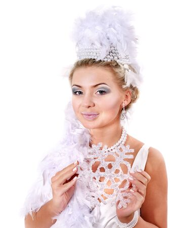 Young beautiful woman holding snowflake. Fashion studio shot. photo