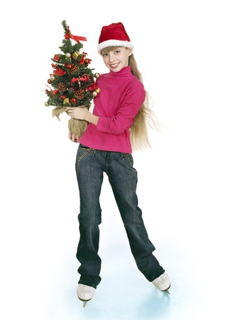 Happy young girl figure skating with christmas tree.. Isolated. photo