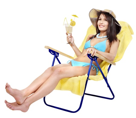 Girl in bikini drink juice through  straw. photo