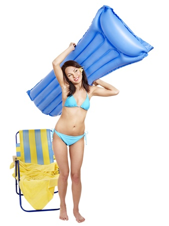 Girl in bikini on beach with mattress. photo