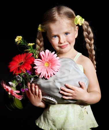 Little girl holding flowers and gas mask . Stock Photo - 11174840