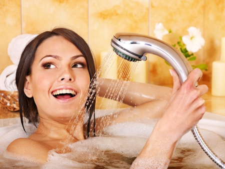 female in douche: Young woman take bubble  bath.