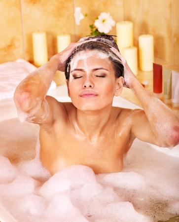 Woman washing hair in bubble bath. Stock Photo - 11174871