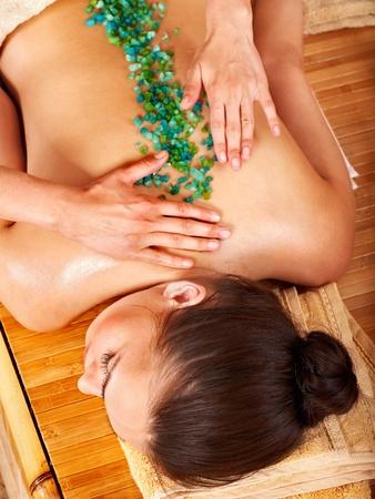 Young woman getting salt massage. photo