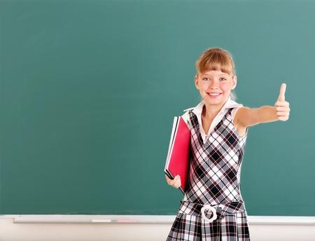 Happy schoolchild near blackboard. Stock Photo - 11174821