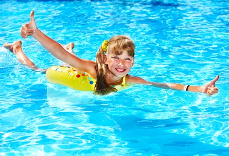 Children sitting on inflatable ring in swimming pool. Stock Photo - 11210010