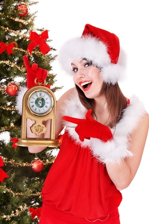 Christmas girl in santa hat pointing on clock..  Isolated. photo