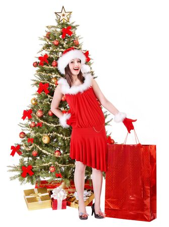 Christmas girl in santa hat giving  gift box.. Isolated. photo