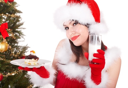 Christmas girl in red santa hat and cake on plate. Isolated. Stock Photo - 11210000