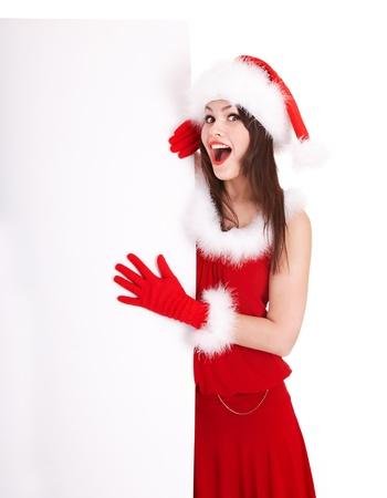 산타 모자: 배너를 들고 산타 모자에서 크리스마스 소녀. 입니다. 스톡 사진