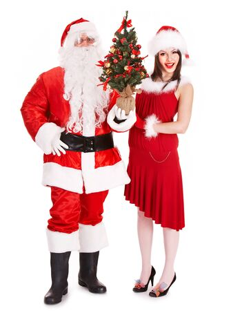 Santa claus and girl holding christmas tree. Isolated. photo