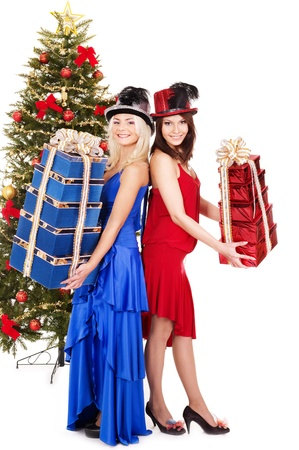 Group young people in party hat with christmas tree. photo