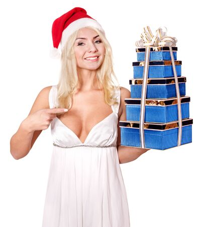 Christmas girl in santa hat holding stack red gift box. Isolated. photo