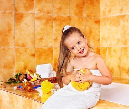 bathe: Child washing in bubble bath . Stock Photo