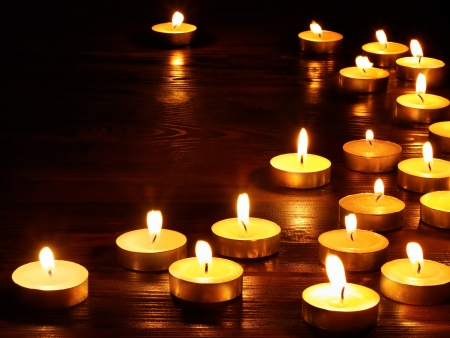 Group of burning candles on  black background. photo