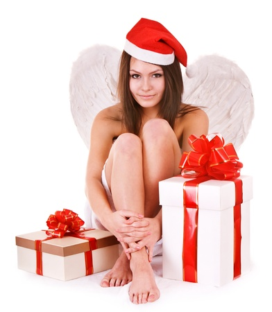 Girl in santa hat holding gift box. Isolated. photo