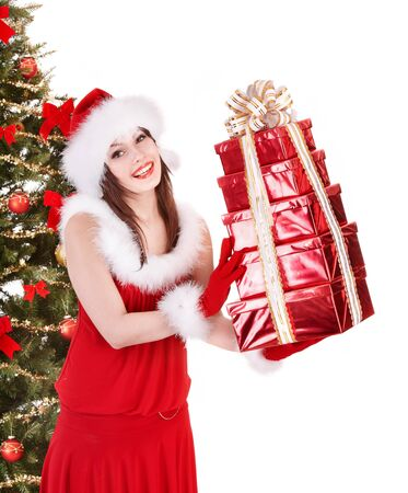 Girl in santa hat holding stack gift box near christmas tree.  Isolated. Stock Photo - 11439292