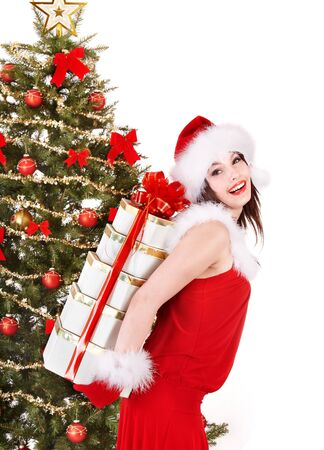 Christmas girl in santa hat holding stack  gift box.. Isolated. photo