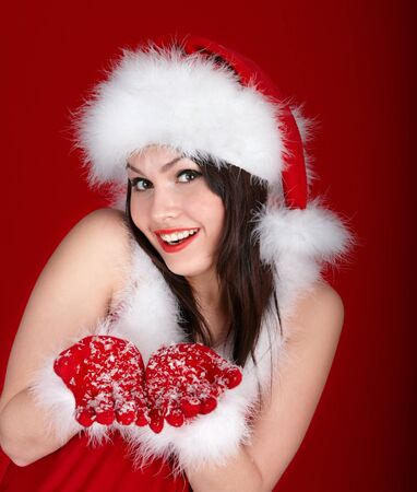 Young woman in Santa hat holding gift box on red background. Stock Photo - 11439293