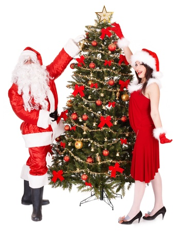 Christmas girl, santa clause and fir tree with gift box group. Isolated. photo
