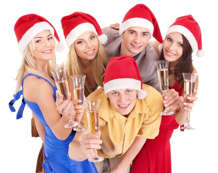 Group young people in santa hat drinking champagne . Isolated photo