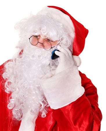 Santa Claus by christmas calling by phone.  Isolated. photo
