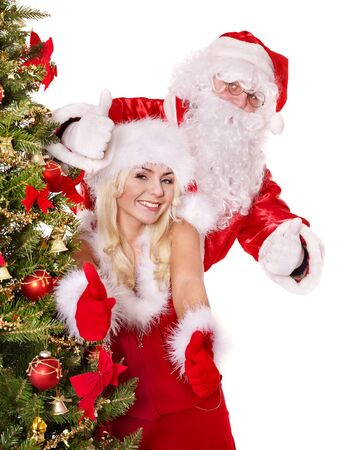 Santa claus and  girl by christmas tree.. Isolated. Stock Photo - 11439301