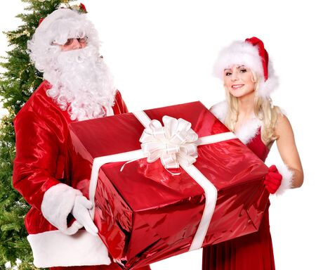Santa claus and  girl holding gift box by christmas tree... Isolated. photo