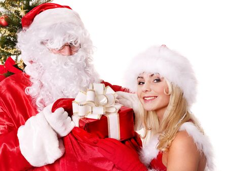 Santa claus and christmas girl holding gift box. Isolated. Stock Photo - 11439348