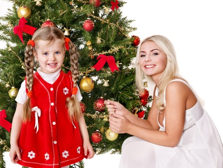 Mum with a daughter decorate christmas tree. Isolated. photo