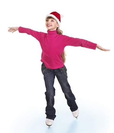 Happy young girl figure skating. Isolated. photo