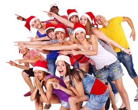 Group people in santa hat pointing. Isolated. photo