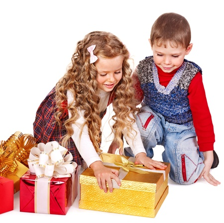 Children with gift box near Christmas tree. Isolated. Stock Photo - 11439369